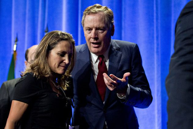 Bob Lighthizer, U.S. trade representative, right, speaks to Chrystia Freeland, Canada's minister of foreign affairs, after opening statements during the first round of North American Free Trade Agreement (NAFTA) renegotiations in Washington, D.C., on August 16, 2017.