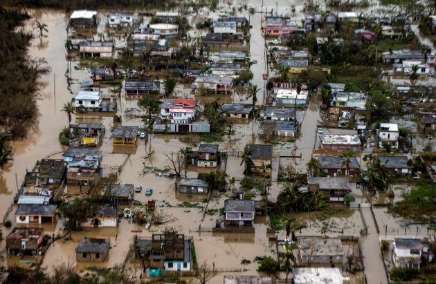 Aerial photos show the extent of flooding and devastation in Puerto Rico. Power and communication is...