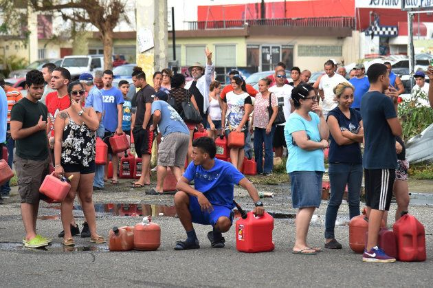 People wait in line to purchase petrol in Arecibo, northwestern Puerto Rico, on September 22, 2017 in...