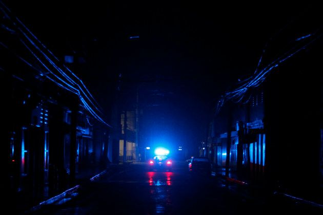 A police car patrols a dark street in the aftermath of Hurricane Maria in San Juan, Puerto Rico, on September...