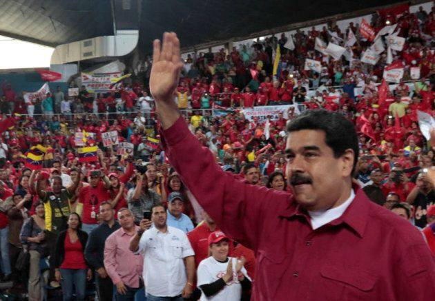 Venezuela's President Nicolas Maduro waves during a pro-government rally with workers of state-run oil...