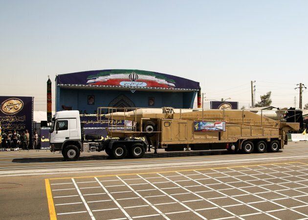 A rig carries ballistic missiles during a military parade in front of former Supreme Leader of Iran,...