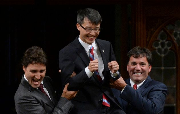 Liberal leader Justin Trudeau (L) and Member of Parliament Dominic LeBlanc (R) lift new Member of Parliament...
