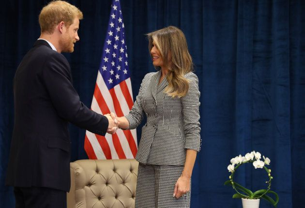 Prince Harry and Melania Trump shake hands. The Invictus Games are the first lady's first solo trip outside...
