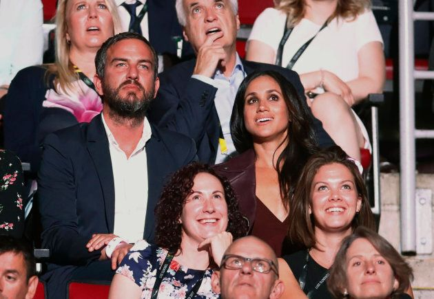 Meghan Markle attends the Invictus Games opening ceremonies Saturday with friend Marcus Anderson (Photo:...
