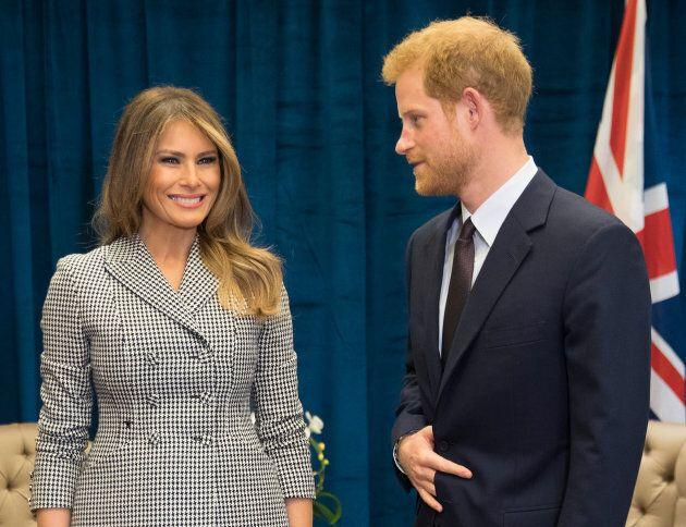 Prince Harry and U.S. first lady Melania Trump pose for photos on Saturday. (Photo: Pool/Samir