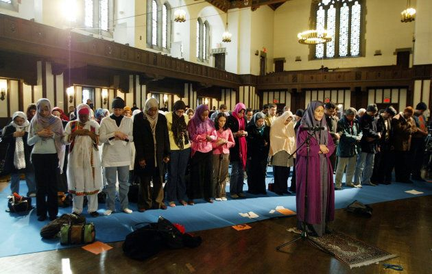 Dr. Amina Wadud (center right) leads a group of women at the first public, mixed-gender Muslim prayer service that was held in New York City, March 18, 2005. Dr. Wadud, is a professor of Islamic studies at Virginia Commonwealth University. The service was held at the Synod House in New York.