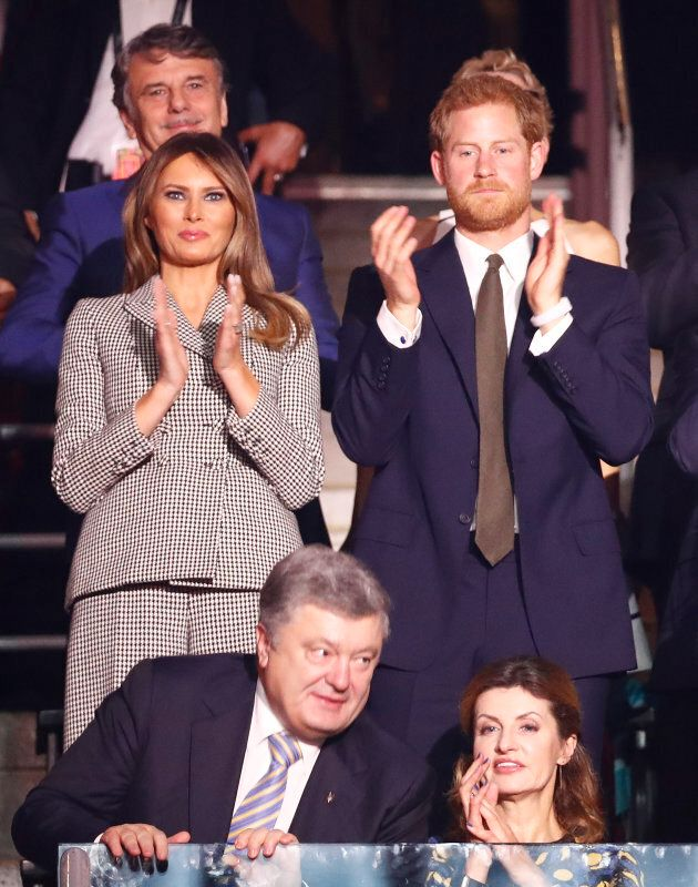 U.S. first lady Melania Trump and Britain's Prince Harry, attend during the opening ceremony for the...