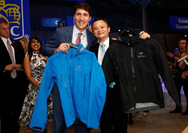 Canada's Prime Minister Justin Trudeau poses with Alibaba founder Jack Ma while holding Arc'teryx jackets...