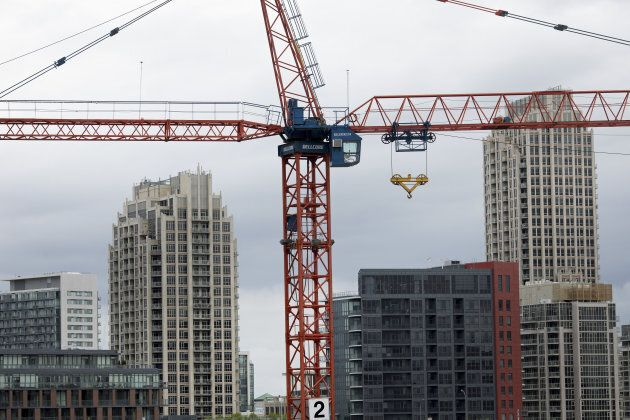 A crane operates at a condominium under construction in Toronto, Friday, May 26. A new report says at...
