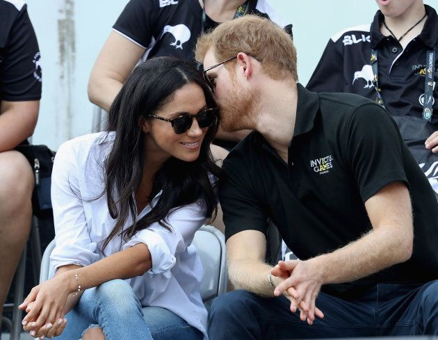 Prince Harry (R) and Meghan Markle (L) attend a Wheelchair Tennis match during the Invictus Games 2017...