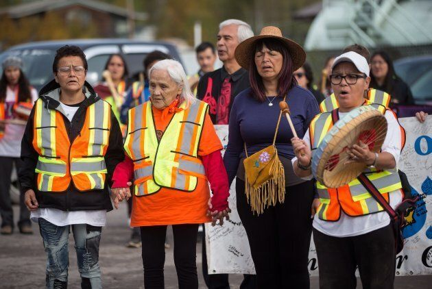 Indigenous women sing before walking with a group of family members and advocates of missing and murdered...