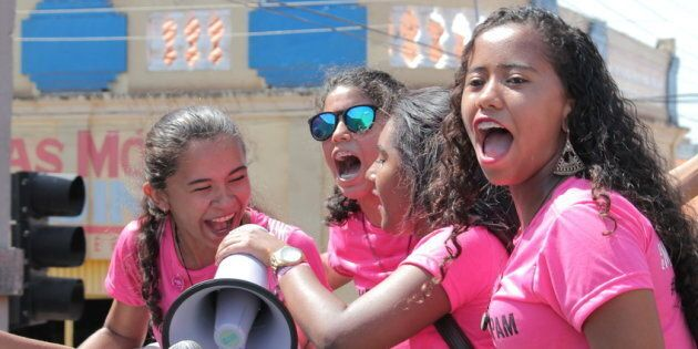 Girls raise their voices during a rally against the rape culture in Brazil.