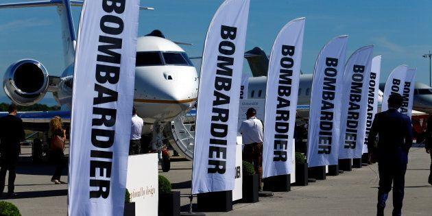 People attend the Bombardier stand during the European Business Aviation Convention & Exhibition (EBACE)...