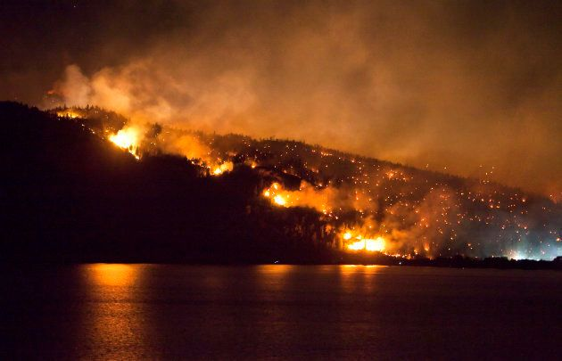 A forest fire burns on the edge of Kelowna, British Columbia, July 19,