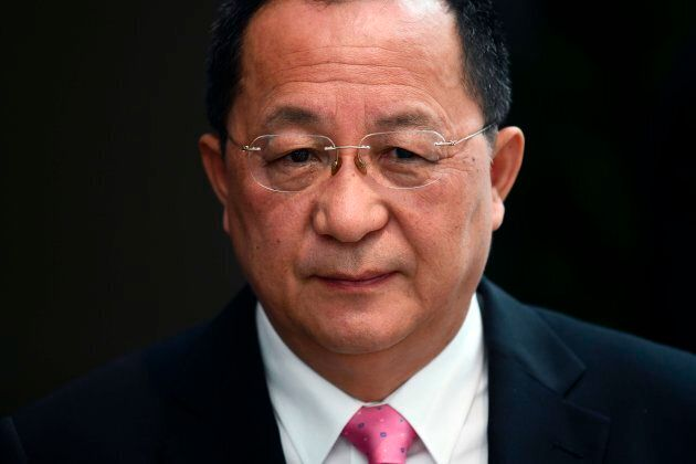 North Korean Foreign Minister Ri Yong-ho speaks to journalists as he leaves his hotel in New York on...