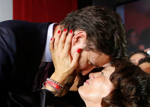 Justin Trudeau is embraced by his mother Margaret Trudeau as he arrives to give his victory speech after...