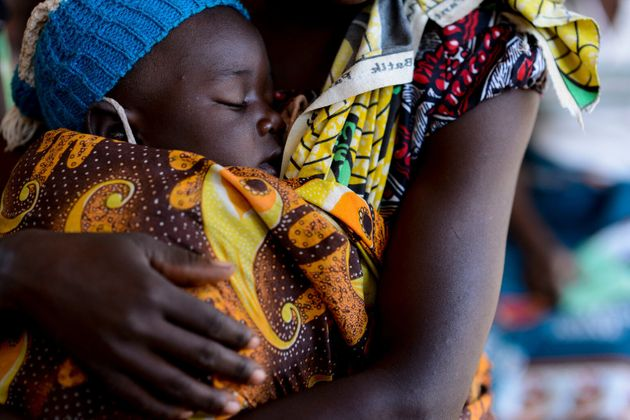 On 29 June 2016, a mother holds a baby at the UNICEF-supported Mfera Health Centre in Chikana district...