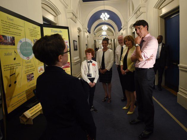 Prime Minister Justin Trudeau and Chief Science Advisor Mona Nemer talk to a participant at a science...
