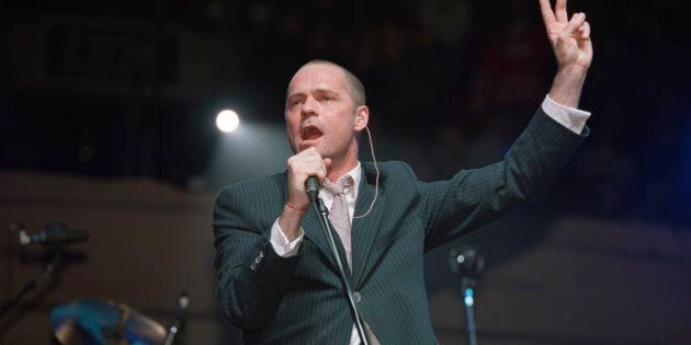 Gord Downie, lead singer for the Tragically Hip, performs at the Air Canada Centre in 2000. (David Cooper/Toronto...