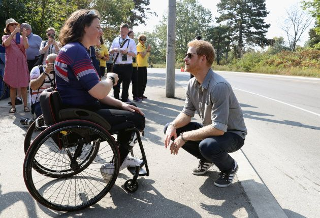 Prince Harry meets up with an athlete as he attends the Cycling Criterium time trial during the Invictus...