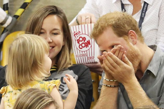 Emily Henson and her mother Hayley Henson sit with Prince Harry at the Sitting Volleyball Finals during the Invictus Games in Toronto on Sept. 27, 2017.