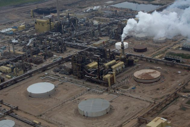 Oil is refined at a Syncrude Canada Ltd. mining site near Fort McMurray, Alta., on Aug. 13, 2013.