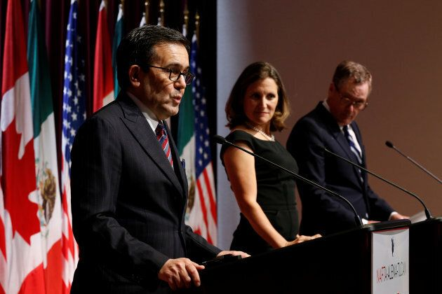 Mexico's Economy Minister, Ildefonso Guajardo (left) addresses the media with Canada's Foreign Minister...
