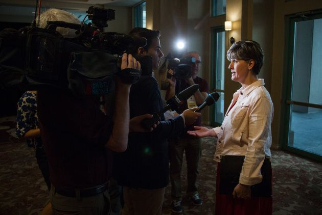 Marie-Claude Bibeau, Canada's minister of international development, speaks to members of the media while arriving at the Federal Liberal Party caucus retreat in Kelowna, British Columbia, on Sept. 7, 2017.