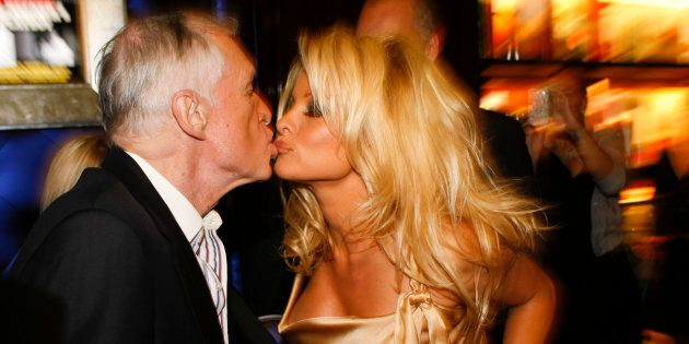 Hugh Hefner and Pamela Anderson attend the Hugh Hefner book signing session on December 10, 2009 in Beverly...