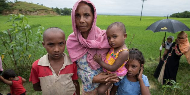 A Rohingya widow whose husband was killed in Myanmar arrives in the Bangladeshi district of Cox's Bazar...