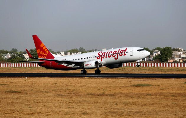A SpiceJet passenger aircraft takes off from Sardar Vallabhbhai Patel international airport in Ahmedabad,...