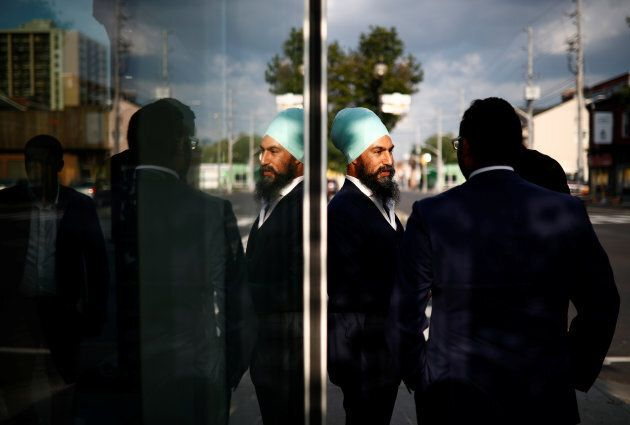 NDP leadership candidate Jagmeet Singh speaks with people at a meet and greet event in Hamilton, Ont....
