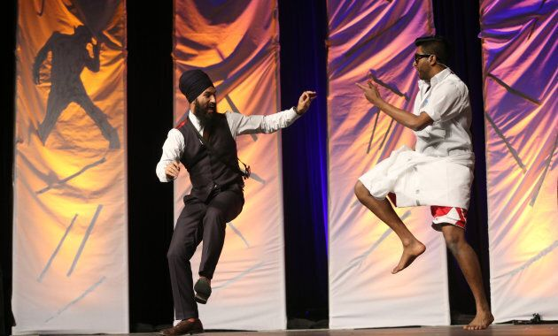 NDP MPP Jagmeet Singh dances on stage with Banugan Kanagaratnam at a dance competition in Toronto on March 22, 2014