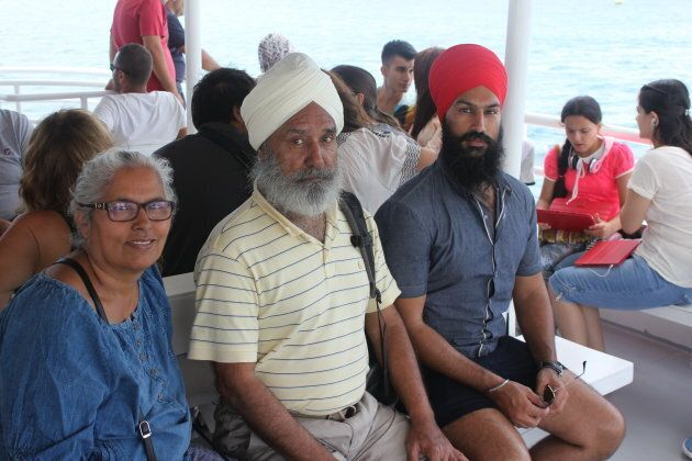 Jagmeet Singh poses with his parents, who immigrated from Punjab to