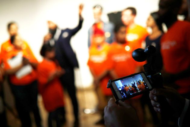 A man livestreams NDP leadership candidate Jagmeet Singh as he speaks at a meet and greet event in Hamilton, Ont. on July 17, 2017.