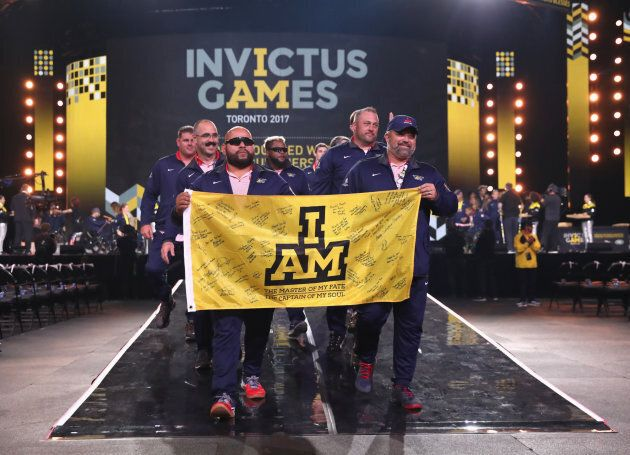 Competitors walk during the closing ceremony of the Invictus Games.