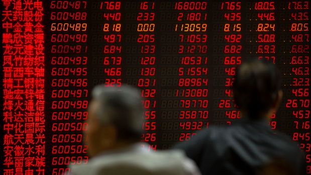 Chinese investors monitor stock prices at a brokerage house in Beijing, Friday, May 10, 2019. President Donald Trump's increased tariffs on $200 billion in Chinese imports are taking effect, heightening tensions with Beijing. At 12:01 a.m. Eastern time Friday, the Trump administration raised the import taxes on those goods from 10 precent to 25 percent. China threatened to retaliate if Trump proceeded with his threat to raise those tariffs (AP Photo/Mark Schiefelbein)