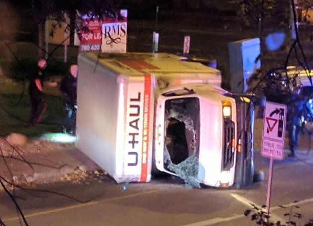 A rental truck lies on its side in Edmonton on Sunday.
