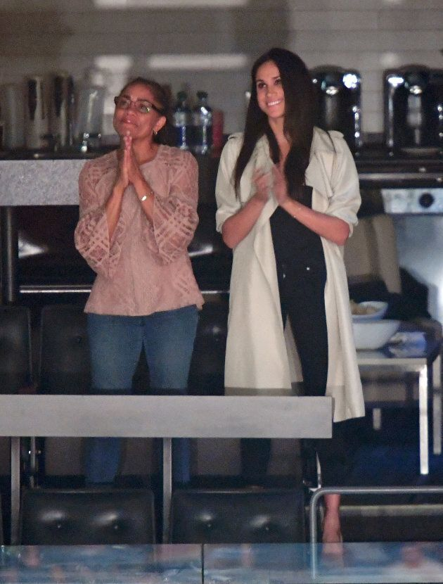 Outfits on point for Doria Radlan and daughter Meghan Markle.