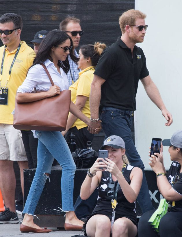 Meghan Markle and Prince Harry at the wheelchair tennis  on day three of the Invictus Games on Monday. Holding hands!