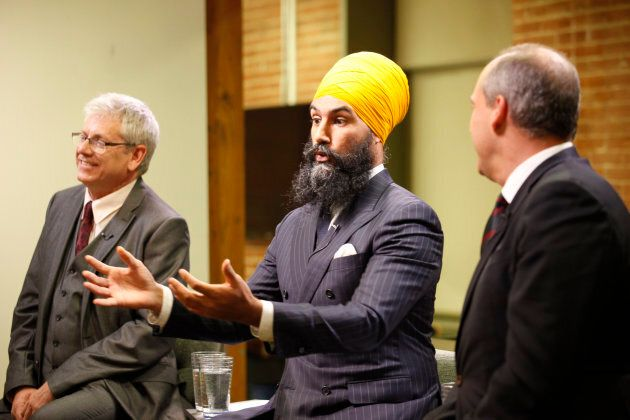 Jagmeet Singh is shown with Charlie Angus and Guy Caron at HuffPost Canada's NDP leadership debate on