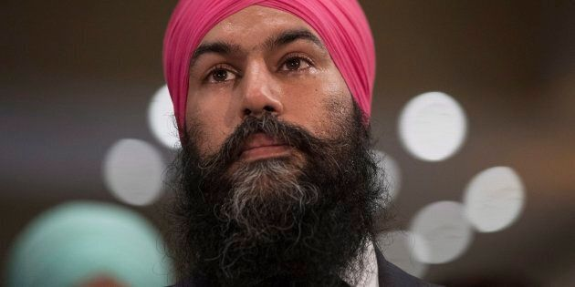 Jagmeet Singh listening to a speech before being elected leader of the federal NDP party in Toronto on...