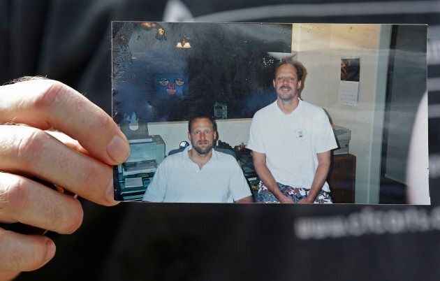 Eric Paddock holds a photo of him and his brother, Stephen Paddock outside his home on Monday.