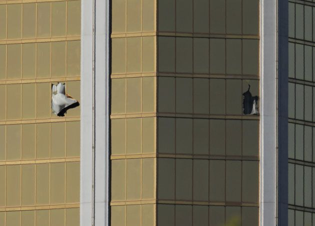 Two broken windows are seen at the Mandalay Bay Resort and Casino following a mass shooting at the Route...