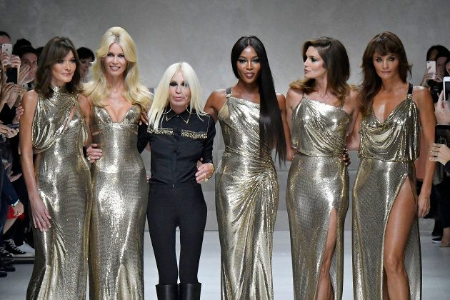 Carla Bruni, Claudia Schiffer, Donatella Versace, Naomi Campbell, Cindy Crawford and Helena Christensen walk the runway at the Versace Ready to Wear Spring/Summer 2018 fashion show during Milan Fashion Week Spring/Summer 2018 on September 22, 2017 in Milan, Italy. (Photo by Victor VIRGILE/Gamma-Rapho via Getty Images)