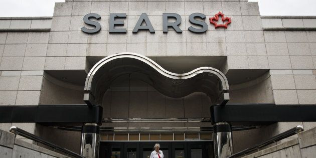 A shopper exits a Sears Canada Inc. store inside a mall in Toronto, Ont., Thurs., June 22. Sears Canada...