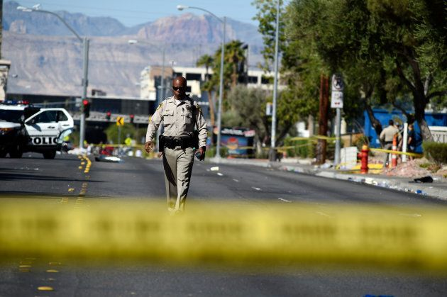 Las Vegas police investigate a side street near the Las Vegas Village after a lone gunman opened fired...