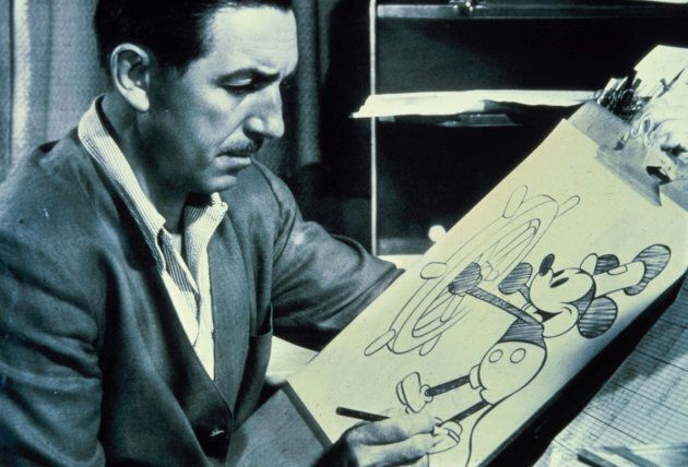 Walt Disney is pictured at the drawing board with a sketch of his famous character, Mickey