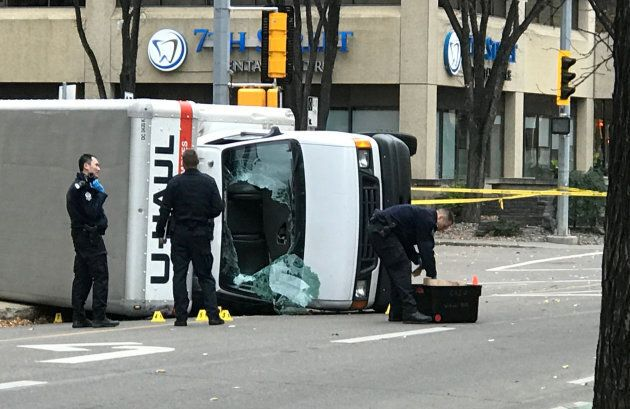 Edmonton Police investigate at the scene where a man hit pedestrians then flipped the U-Haul truck he...